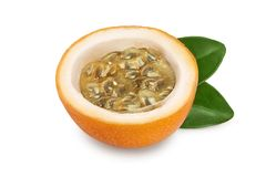 Granadilla or yellow passion fruit half with leaf isolated on white background.  royalty free stock photos