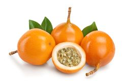 Granadilla or yellow passion fruit with leaf isolated on white background.  stock photography