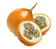 Granadilla or yellow passion fruit pieces isolated on white. Background as package design element Stock Images