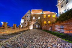 Granaries with water gate in Grudziadz. At night, Poland Royalty Free Stock Photos