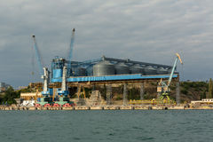 Granary and cargo port cranes in Sevastopol Bay Stock Photography