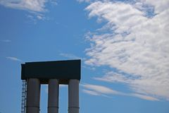 GRANARY WITH CLOUDS AND SKY. Tall granary against blue sky and clouds Royalty Free Stock Image