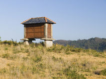 A granary in the field. The granary is used to store grain Royalty Free Stock Images