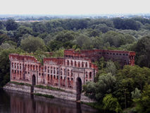 Granary. Old granary on the banks of the river Royalty Free Stock Image