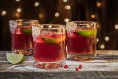 Granatäpplesötsak och sur dryck Arkivfoto