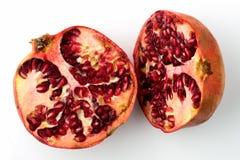 Granatapfel geteilt zur Hälfte Stockbild