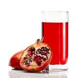 Granatapfel mit Glas Saft Lizenzfreies Stockfoto