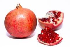 Granatapfel mit Scheibe Lizenzfreies Stockbild