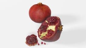 Granatapfelfrucht auf weißem Hintergrund Lizenzfreie Stockfotos