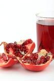 Granatapfelfrucht mit Saft Stockfotografie