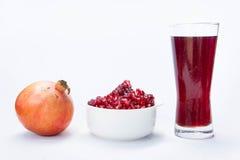 Granatowa owocowy sok, granatowa sok wydobujący w wodę Fotografia Royalty Free