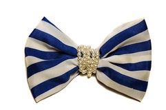 Grand arc blanc avec les rayures bleues avec des perles Photos stock