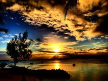 Grand Baie, Mauritius. Beautiful sunset with clouds over the sea in Grand Baie, Mauritius Stock Images