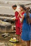 Eople pray at Ganga Talao Grand Bassin Hindu temple, Mauritius. Grand Bassin, Mauritius - December 02, 2012: Unidentified people pray at Ganga Talao Grand stock photos