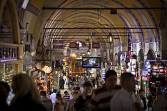 The Grand Bazaar Interior in Istanbul. ISTANBUL, TURKEY – APRIL 26: Interior of the Grand Bazaar in Istanbul with tourists and local Turkish people prior to Stock Image