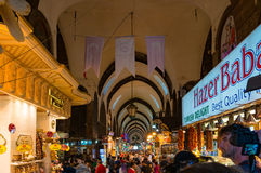 Grand Bazaar interior with sellers and tourists Stock Photography
