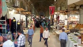 Grand bazaar of Isfahan with tourists and people shopping, Isfahan, Iran stock footage