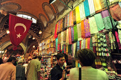 Grand Bazaar Istanbul. The Grand Bazaar in Istanbul, Turkey.Tourist  bargaining with local business man Royalty Free Stock Image