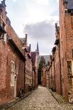 Street in the 13th century Grand Beguinage of Leuven, Belgium. The Grand Beguinage Groot Begijnhof of Leuven Louvain, Lovania, Belgium is a well preserved 13th royalty free stock image
