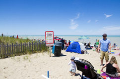 Grand Bend Ontario, Canada - July 02, 2016:  Unidentified people. In the beach of Grand Bend  in leisure acivities in summertime as editorial Stock Photos