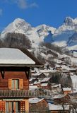 Grand-Bornand chalets, France. View on the Aravis mountains from the Grand-Bornand with its beautiful wooden chalets, France Stock Photography
