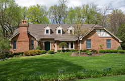 Grand Brick Home with Landscaped Lawn Royalty Free Stock Photography