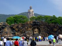 Grand Buddha statue with murals in the front Royalty Free Stock Photos