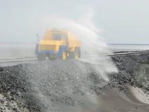 Grand camion pour arroser le liquide Image libre de droits