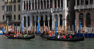 Grand Canal. Venice,Italy- July 28th, 2011: Image of three gondolas with tourists in front of traditional venetian buidlings on the Grand Canal in Venice Royalty Free Stock Photo