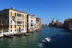 Grand Canal with authentic Venetian buildings and docks. Authentic Venetian buildings and docks seen from a big bridge over the Grand Canal Stock Image