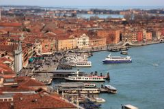 Grand Canal with boats and Basilica Santa Maria della Salute with tilt-shift effect. Venice, Italy royalty free stock images
