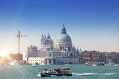 Grand Canal with boats and Basilica Santa Maria della Salute, Venice, Italy Royalty Free Stock Photography