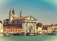 Grand Canal with boats and Basilica Santa Maria della Salute, Venice, Italy , Stock Image
