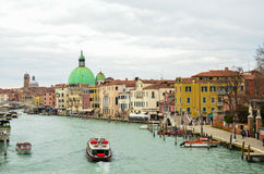 Grand canal with boats and the reflection of the old colourful houses in the water, Venice, Italy Royalty Free Stock Image