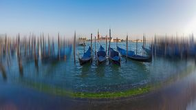 Grand Canal with gondolas in blur motion. Fish eye view of Grand Canal with gondolas and San Giorgio Maggiore church. Motion blur filter applied Royalty Free Stock Photos