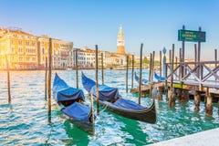 Grand Canal Gondolas at the pier - gondola customs service and San Giorgio Maggiore church.  royalty free stock image