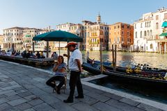 Grand Canal. tourists enjoy the views of the city, gondoliers expect passengers. Venice, Italy - June, 21, 2013: evening on the Grand Canal. tourists enjoy the Royalty Free Stock Image