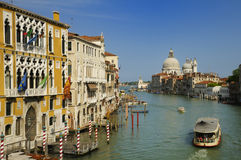 The Grand Canal, Venice. A vaporetto or water-bus on the Grand Canal, Venice, Italy Stock Photos