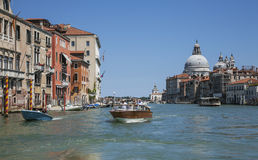 The Grand Canal in Venice/blue waters and skies, gondolas and historic buildings. Royalty Free Stock Photo