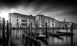 Grand canal in Venice. Grand canal with gondolas in beautiful town Venice Italy. Very long exposure photography Stock Photo