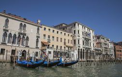 The Grand Canal in Venice/gondolas on the blue waters and historic buildings. Royalty Free Stock Image