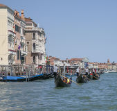 The Grand Canal in Venice/gondolas on the blue waters. Stock Image