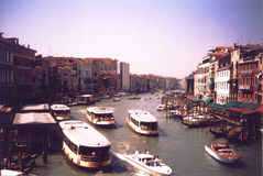 Grand canal - Venice Italy. Boats on Canal Grande or Grand Canal Venice Italy (Visible film grain royalty free stock photography