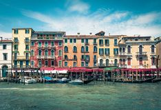 Grand Canal in Venice, Italy. Venice, Italy - May 18, 2017: Scenery street with hotels, restaurants and a pier for boats on the Grand Canal. The Grand Canal is Royalty Free Stock Photos