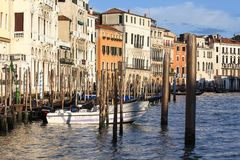 Grand Canal, vintage buildings, parked boats at the marina, Venice, Italy Stock Images