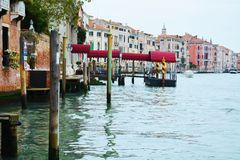 Grand Canal and wooden poles in Venice, Italy Stock Photos