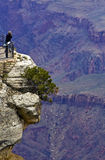 Grand Canyon, Arizona. Tourist on a rock on the south rim of the Grand Canyon Stock Photos