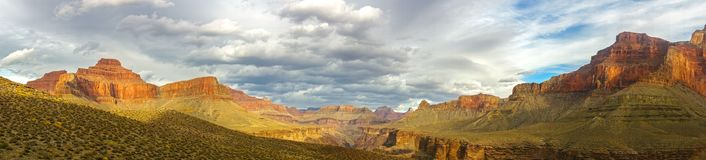 Grand Canyon Arizona Panoramic Landscape and Dramatic Stormy Sky. Wide Panoramic Landscape and Dramatic Cloudy Sky over Arizona Grand Canyon National Park from Royalty Free Stock Image