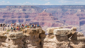 GRAND CANYON,ARIZONA,USA-AUGUST 9,2014:  People enjoy the view o Royalty Free Stock Photo