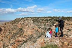 Grand Canyon besökare royaltyfri foto